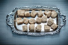 Brown sugar tray on striped background Stock Photo