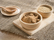 Brown sugar and wheat germ in wooden bowl Royalty Free Stock Image