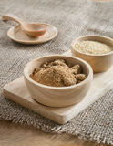 Brown sugar and wheat germ in wooden bowl Stock Photography