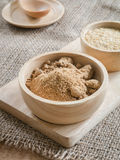 Brown sugar and wheat germ in wooden bowl Royalty Free Stock Photography