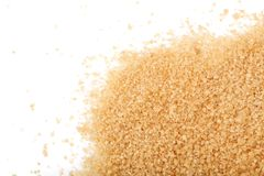 Brown sugar  on white background with copy space for your text. Top view. Flat lay.  Stock Photography