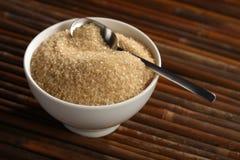 Brown sugar in white bowl Stock Photos