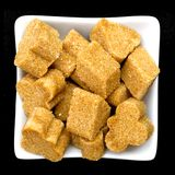 Brown sugar in a white bowl on black Stock Photo
