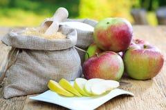 Brown sugar, white sugar and apples Royalty Free Stock Photo