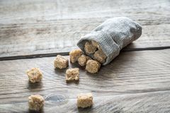 Brown sugar on the wooden background Stock Photo