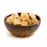 The brown sugar in a wooden bowl Stock Photography