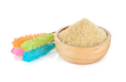 Brown sugar in wooden bowl and sugar stick on white Stock Photo