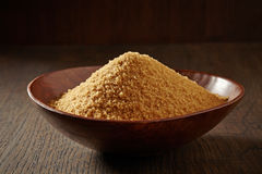 Brown sugar in a wooden bowl Royalty Free Stock Photos