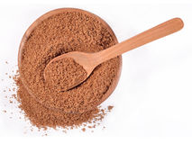 Brown sugar in a wooden bowl on a white Stock Photography
