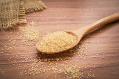 Brown sugar on wooden spoon Stock Images