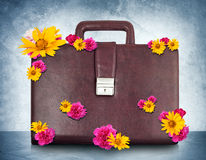 Brown suitcase with flowers Stock Photos