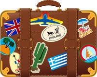 Brown suitcase with label Stock Photos