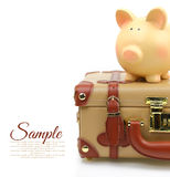 Brown suitcase with piggy bank Royalty Free Stock Photography