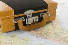 Brown suitcase for travel. Brown suitcase om map for travel the world Royalty Free Stock Image