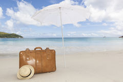 Brown suitcase under sunshade Royalty Free Stock Images
