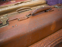 Brown suitcases. Close-up of diagonally above on multiple brown suitcase with handle and suitcase lock Royalty Free Stock Images