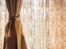 Brown sunlit curtain stock photo