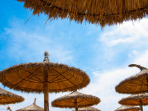 Brown sunshades made of straw Royalty Free Stock Photography
