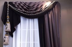 Brown Swag. Curtains with tassels on window with sheers Stock Photography