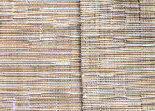 Brown synthetic fabric pattern and middle border line Royalty Free Stock Photography