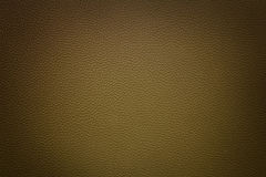 Brown synthetic leather  background with vignette Royalty Free Stock Photos