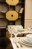 Brown table, which served for two  porcelain plates and wine gla Royalty Free Stock Images