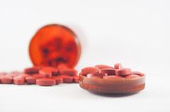 Brown tablet on medicine bottle background Stock Images