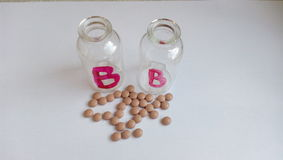 Brown tablets with a glass jar Royalty Free Stock Image