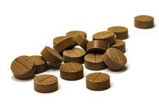 Brown tablets Mumio Shilajit royalty free stock photo