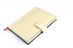 Brown-Tagebuch auf lokalisiertem Hintergrund Lizenzfreie Stockfotografie