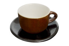 Brown tea cup and black saucer isolated over white Royalty Free Stock Photography