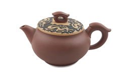 Brown teapot with dragon ornament on lid Royalty Free Stock Photo