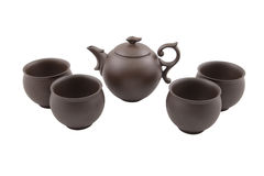 Brown teapot with four bowls Stock Images