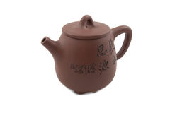 Brown teapot with hieroglyphic ornament Stock Image