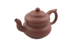 Brown teapot with hieroglyphic ornament Stock Images