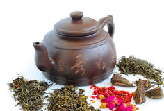Brown teapot and loose tea royalty free stock photo