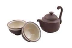 Brown teapot with two bowls Stock Photos