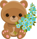 Brown teddy bear with blue flowers Stock Images
