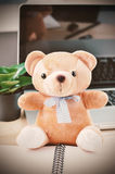Brown teddy bear with blue ribbon bow Royalty Free Stock Photography