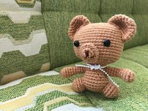 Brown teddy bear crochet doll Stock Photos