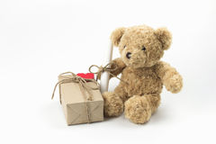 Brown teddy bear with gift box paper red heart and letter roll. Brown teddy bear with gift box paper red heart and letter roll on white background Royalty Free Stock Photo