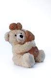 Brown teddy bear, hope. Cheerfull brown teddy bear hugging a pillow Stock Image