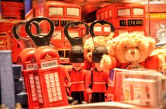 Brown Teddy Bear Near Red Miniature Telephone Booth Royalty Free Stock Photo