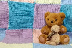 Two teddy bears on a knitted background royalty free stock image