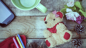 Brown teddy bear with toys for children. Royalty Free Stock Photography
