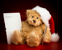 Brown Teddy Bear Writing a Letter to Santa Claus Stock Images