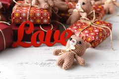 Brown teddy bears with red gift box on white Stock Image