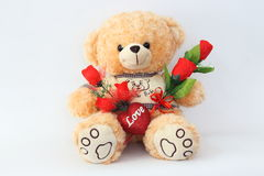 Brown teddy bears and red roses. Royalty Free Stock Photos