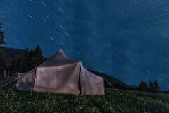 Brown Tent on Green Grass during Night Time royalty free stock photos
