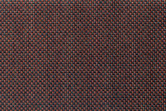 Brown textile background with checkered pattern, closeup. Structure of the fabric macro. Royalty Free Stock Image